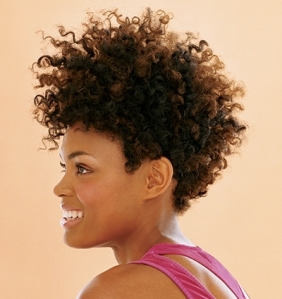 A heightened curly fro gets you noticed for all of the right reasons.  Tightly coiled hair remains keeps hair off of your face, but still makes a stylish statement.