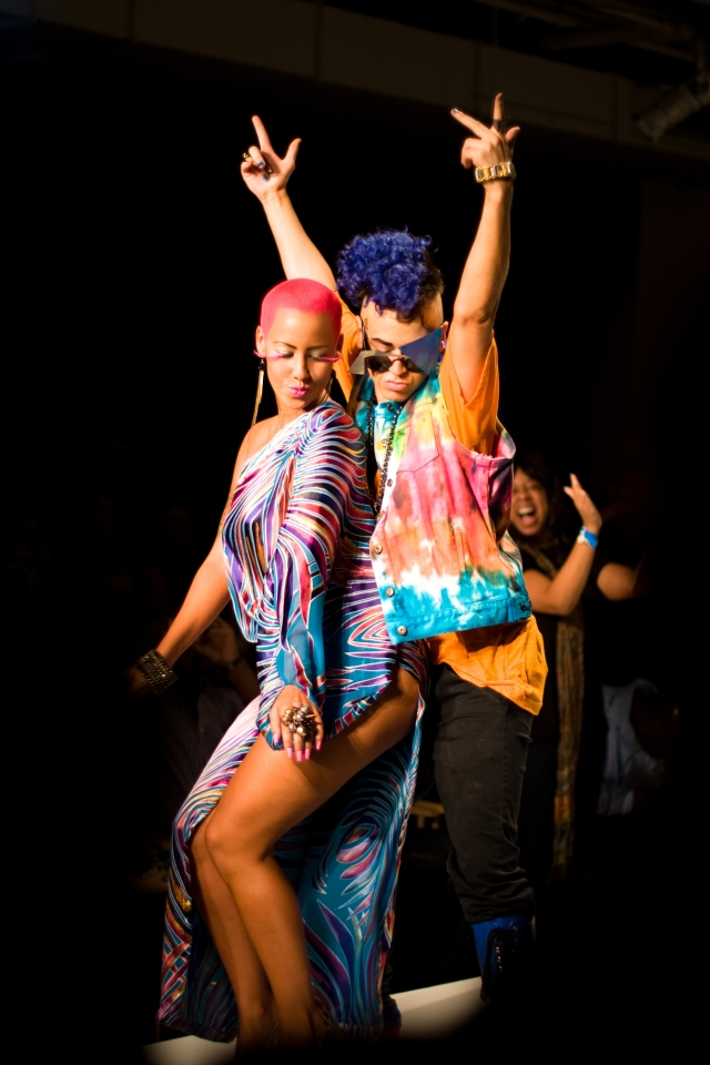 Designer Indashio and Amber Rose dance to close the final look for the show