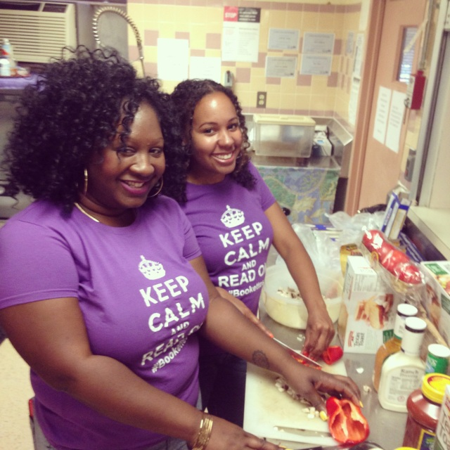 Bookettes Fefe and Jennifer prepare dinner at Samaritan Inns.